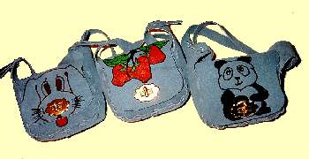 Big Girl and Little Girl suede purses with animal faces painted or drawn on flap